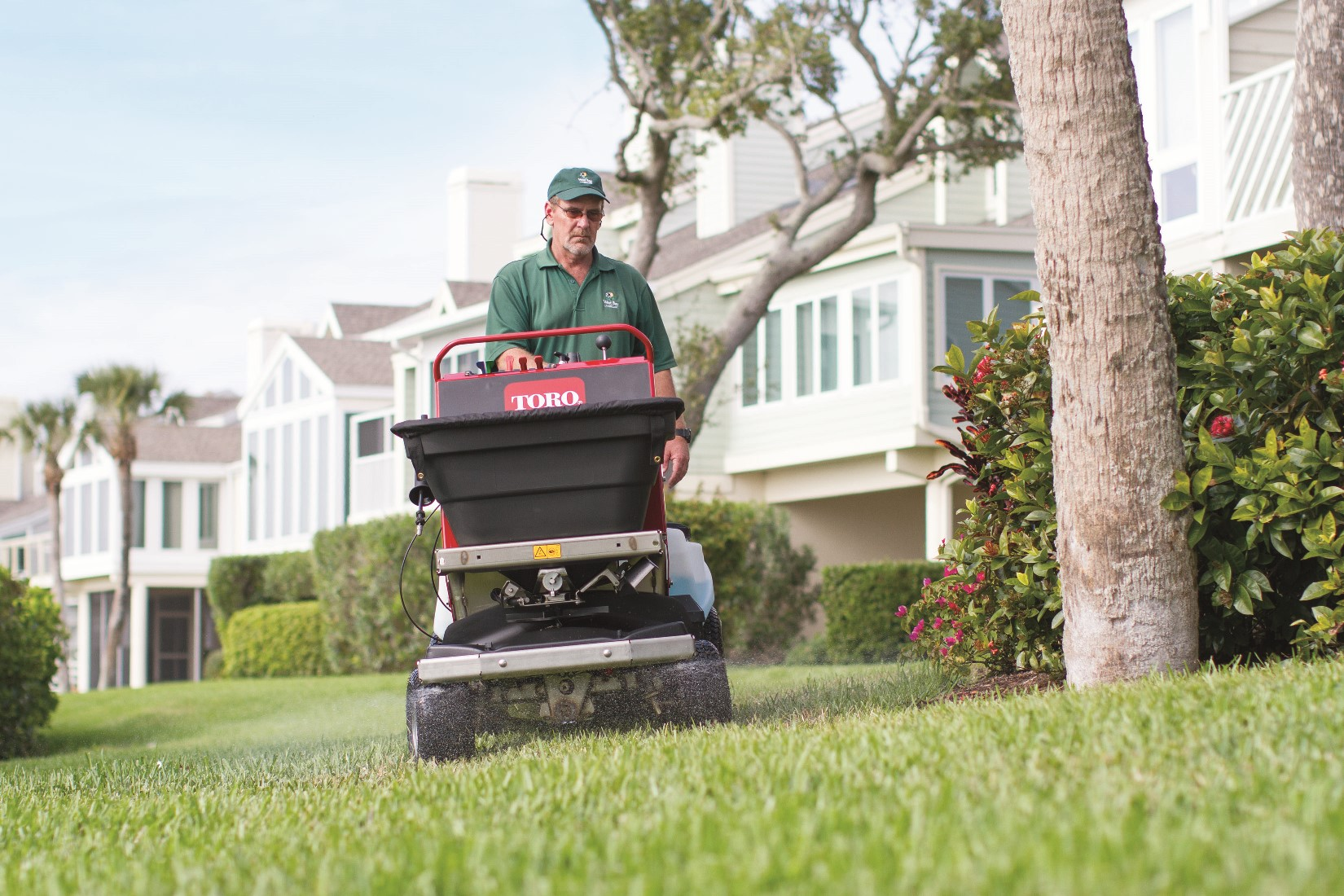 Turf Renovation made easy with the Toro Stand-on Spreader Sprayer